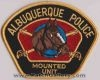 Albuquerque_Police_patches_-_Mounted_Unit_-_Black_with_gold_border.jpg